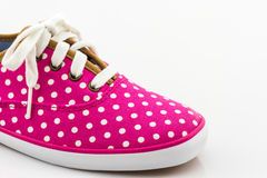 Pink polka dot canvas shoe. Stock Photo