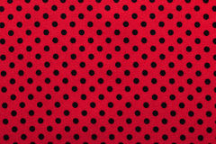 Pink polka-dot cotton fabric directly above Stock Photography