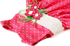 Pink polka-dot dress with artificial textile flowers Royalty Free Stock Photo