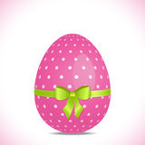 Pink polka dot easter egg with green ribbon Royalty Free Stock Image