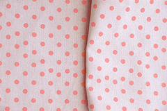 Pink polka dot fabric for background Stock Images