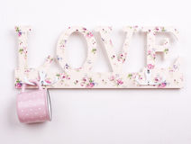 a pink polka dot mug with love hang Stock Image