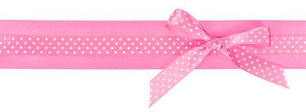 Pink polka dot ribbon with a bow Stock Photos