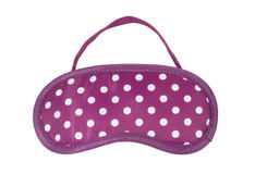 Pink polka-dot sleeping mask Royalty Free Stock Photo