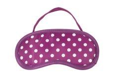 Pink polka-dot sleeping mask Royalty Free Stock Photo