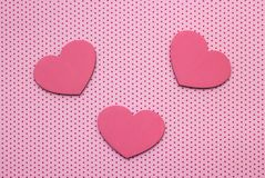 Pink polka dots background and hearts from wood royalty free stock images