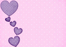 Pink Polka Dots Background with Purple Hearts. This is designed with purple polka dot hearts falling down the side of a pink polka dotted background. This is vector illustration