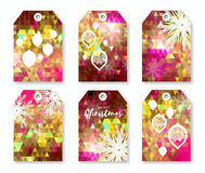 Pink polygonal Festive collection of Christmas labels with snowflakes. Stock Photos