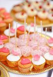 Pink pop cakes and cupcakes Stock Image