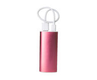 Pink portable power bank for charging mobile devices isolated on white background.  royalty free stock photography