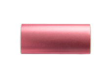 Pink portable power bank for charging mobile devices isolated on white background Stock Image