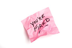 Pink post it note isolated on white. With you're fired written Royalty Free Stock Photography