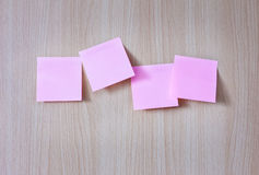 Pink post it paper on wood board Royalty Free Stock Photography