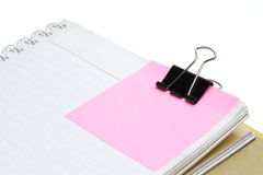 Pink postit. Clip on book Stock Photo