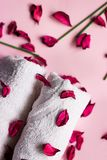 Pink potpourri, white towels, scented sticks and aromatic oil on. Pink background; spa or wellness background stock photography