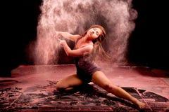 Pink powder dance pose Royalty Free Stock Photos