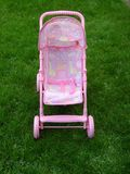 Pink Pram. On green grass Royalty Free Stock Images