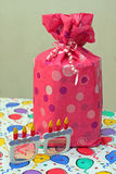 Pink present and birthday glasses Royalty Free Stock Image