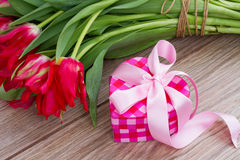 Pink present box with flowers Stock Images