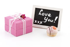 Pink present and a chalckboard Stock Photos