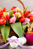 Pink present and colorful tulips festive easter decoration Royalty Free Stock Photography