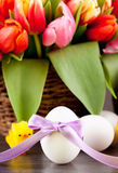 Pink present and colorful tulips festive easter decoration Stock Image