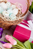 Pink present and colorful tulips festive easter decoration Stock Photos
