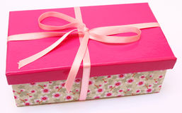Pink Present. With a flower base box with a pink ribbon Stock Photography