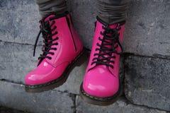 Pink punk alternative girl or woman shoes - sitting tough stock photo