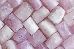 Pink purple background of natural stones. Kunzite is a natural p stock photography