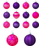 Pink and Purple Baubles. A vector illustration of pink and purple different patterned Christmas baubles on a white background royalty free illustration