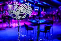 Masquerade Mask at corporate event or gala dinner. Pink and Purple Blue Decor Masquerade Mask at corporate event or gala dinner stock images
