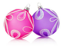 Pink and purple Christmas balls isolated on the white background Royalty Free Stock Photography