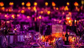 Pink and Purple Christmas Decor with candles and lamps for a large party or Gala Dinner royalty free stock photos