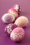 Pink and purple crochet Easter eggs. Easter eggs with beautiful pink and purple crochet decoration Royalty Free Stock Photography