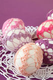 Pink and purple crochet Easter eggs. Easter eggs with beautiful pink and purple crochet decoration Royalty Free Stock Image