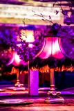 Decor with candles and lamps for corporate event or gala dinner. Pink and Purple Decor with candles and lamps for corporate event or gala dinner Royalty Free Stock Photos