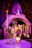 Decor with candles and lamps for corporate event or gala dinner. Pink and Purple Decor with candles and lamps for corporate event or gala dinner Stock Photos