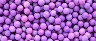 Pink and purple dragee balls background, letterbox format Stock Image
