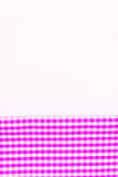 Pink, purple fabric, a kitchen towel with a checkered pattern, o. N a white background isolated Stock Images