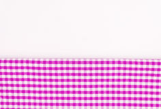 Pink, purple fabric, a kitchen towel with a checkered pattern, o. N a white background isolated Stock Photo