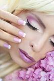 Pink purple French manicure and makeup. Stock Photo