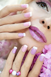Pink purple French manicure and makeup. Stock Photography