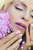 Pink purple French manicure and makeup. Royalty Free Stock Images