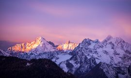 The Pink and Purple Game. The Sun is highlighting the peaks while spectacular pink and purple tones set alight the sky around. Verbier, Alps, Canton du Valais royalty free stock images