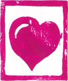 Pink-purple Heart - Linocut print. Linocut art print on pastel paper which contains visible fibers. Created and printed by the photographer. For Christmas or Royalty Free Stock Image