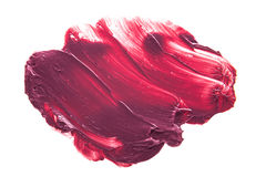 Pink purple lipstick smudge. Pink lipstick smudged on a white isolated background Stock Images