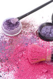 Pink and purple makeup powder and brush. Royalty Free Stock Photos