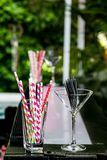 Pink and purple straws in a glass at a cocktail bar royalty free stock photo