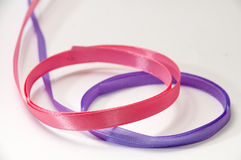 Pink and purple strip for tying bow and packaging Royalty Free Stock Photos
